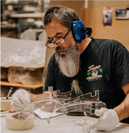 Thermofab team member works on lung enclosure